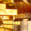 """Figure 5 – Tip of Escape-Wheel Tooth Resting on Deadbeat Pallet Face<br /> <br /> The Graham deadbeat escapement is designed such that the tip of an escape wheel tooth falls onto a pallets dead beat face when the other pallet """"releases"""" the escape wheel.     Typically the anchor will then continue to follow the motion of the pendulum, slightly increasing the """"lock"""" (the distance between where the tip of the escape-wheel tooth rests on the dead beat face and the break point between the deadbeat and the impulse pallet faces – Dimension """"L"""" in Figure 5).  The pendulum then reverses its motion, and the tip of the escape wheel tooth slides off of the deadbeat face and onto the impulse face.  The pendulum is pushed (or impulsed) during the time that the escape-wheel tooth tip slides down the impulse face (Dimension """"I"""" in Figure 5).  When the tip of the tooth falls off the end of the impulse face a tooth on the other side of the escape wheel falls onto the deadbeat face of the opposite pallet.<br /> <br /> There are two criteria that I check to make sure the escapement is set up correctly – drop and lock.  Drop is the distance between the tip of an escape-wheel tooth and the deadbeat face of the pallet just as the opposite pallet releases the escape wheel.  It is important that the drop be equal for both pallets – this assures that a deadbeat escapement can be set up with sufficient lock.  As mentioned above, a future Tid-Bit will discuss adjusting drop.  <br /> <br /> Which brings us to """"lock"""".  A pallets initial lock is the distance between the initial contact point of an escape-wheel tooth and the break point between the two faces – Distance """"L"""" in Figure 5.<br /> <br /> When setting up an escapement I set the initial lock such that it is roughly 60% of the length of the impulse face.  This is shown in Figure 6."""