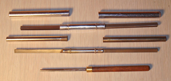 Figure 1 – Two commercially-available burnishers and my mentor's hand-made burnisher<br /> <br /> Additional examples of burnishers that were available years ago - Elgin sapphire burnishers shown in Figure 2.