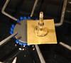 Figure 2 – Placing the shellac chuck<br /> <br /> Next I placed the flat face of the shellac chuck on the melted shellac