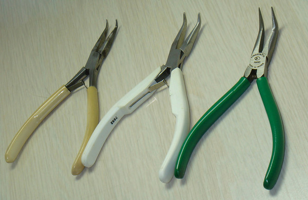 """Figure 2 – Variations in Lindstrӧm Bent-Nose Pliers<br /> <br /> Figure 2 shows three pairs of bent-nose needle-nose pliers, one old, and two new, all three by the same maker - Lindstrӧm.<br /> <br /> The new pairs (center and right) have very crisp edges to the jaws and a very solid feel.  The center pair, the more expensive of the two, is not comfortable to use, and only get pulled out when I really need a very square edge to the jaws.  The left-hand pair, the pair I use every day, are, to my way of thinking, perfect.  Very usable, but the edges of the jaws are slightly rounded from the perhaps thousands of times they have been used - they came to me used, like so many of my most prized tools.  This pair is not as prone to scratching or scoring things that I pick up specifically because of the rounded edges of the jaws.  This pair is very comfortable to use.  <br /> <br /> The third pair is a lesser-price new pair that comes as part of a set of pliers.  They have a good feel and are, to my mind, nicer to use than the pricier pair in the middle of Figure 2.<br /> <br /> Rounded edges?  Good feel?  <br /> <br /> I revere the feeling of tools made at a time when tools were hand-made. These older tools were often works of art in their own right. And, in part also, I love the feel that comes with the soft patina of use – no rough edges, no burs waiting to nick my fingers, everything """"of a piece"""" as a Brit might say.  The Japanese have a term for what I love in tools – Wabi-sabi.  This 16th century thinking refers to a reverence for authenticity above all else. It seems that roughly 500 years ago there was a Tea Master named Sen no Rikyu who rejected the practice of tea ceremonies so ostentations, exclusive and complex that only the most privileged few were able to participate. Rikyu brought the ceremonies to the masses by building tea rooms in the style and spirit of farmers' huts, with rough mud walls, thatched roofs and misshapen exposed-wood structural elements. He """
