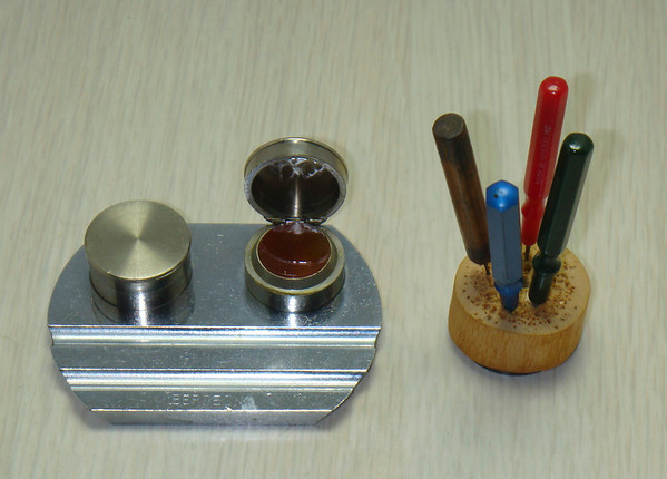 """Figure 8 – Oil Reservoir and Oilers<br /> <br /> On the left side of my bench I keep a set of watch oilers and an oil reservoir (Figure 8). These oilers are discussed in Tid-Bit 22, """"Of Oil, Oilers and Oil Sinks"""" which appeared in the January 2014 Bulletin."""