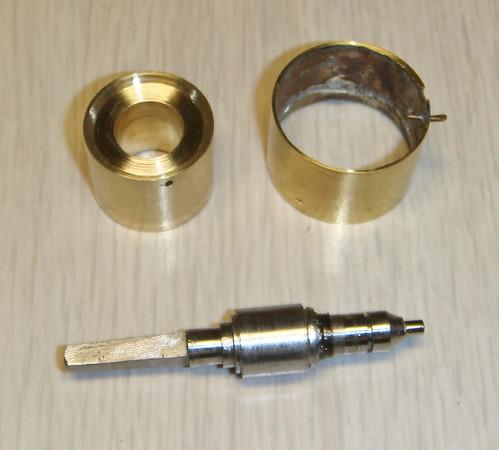 Figure 6 - The new winding drum next to the original drum with the original arbor beneath them.