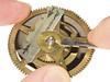Tid-Bit 12 - Tips for Working on Vienna Regulator Winding Drums : Published in the February 2012 NAWCC Bulletin, starting on page 65. It is a good idea, when servicing any weight-driven clock, to remove the gear from the winding drum arbor so you can restore all of the pivots on the winding arbor. When servicing a Vienna Regulator mechanism I always remove the gear, and then remove the spring, and the pawl from the gear before cleaning the parts in cleaning solution. I then stone and burnish all of the bearing surfaces on the arbor – including the section of the arbor on which the gear rides. While removing the gear is often a fairly straight forward proposition, the mechanisms made in Vienna tend to be not quite so simplistic, at least at first glance. The gears for both German and Viennese winding drums are typically held onto the arbor by a slotted washer. While many of the German factory-made Vienna-style mechanisms use a screw to retain these slotted washers (see Figure 1), the Viennese recessed these pesky little washers into the gear (Figure 2). The first time you see one you might just decided you don't need to take it apart. None the less, with the simple technique that is the first subject of this Tid-Bit, you too will be able to laugh at this technical challenge and slip the washer right out!