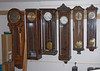 Some of the larger wall clocks, these ones didn't find a home in the house.  Note the two on the right side - a great wheel clock and a month-duration 3 weight Happacher.
