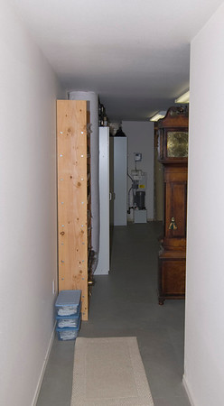 Hallway back into floor-standing clock area.