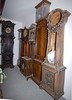Most of the clocks are unpacked, the one with the base in front of it is roughly 9 foot tall when the body is stacked on the base.  Note too that I have a few British Long Case clocks - two toward the end of this row.