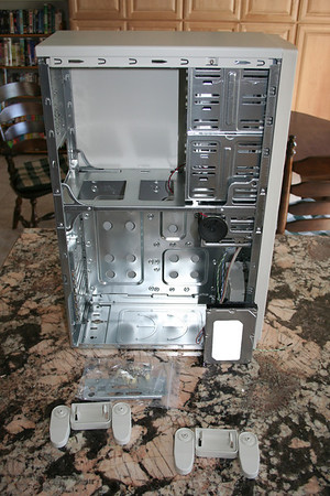Side of the tower with side panel off, and all parts laid out in front