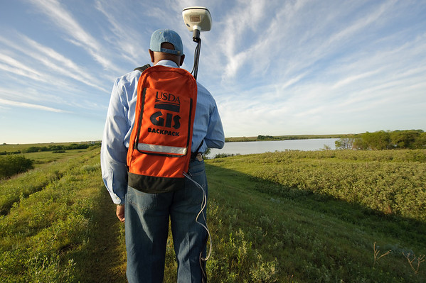 NRCS District Conservationist employee utilizing GPS technology at the Larry Finsterwald dam - site 21 in the Upper Washita Watershed