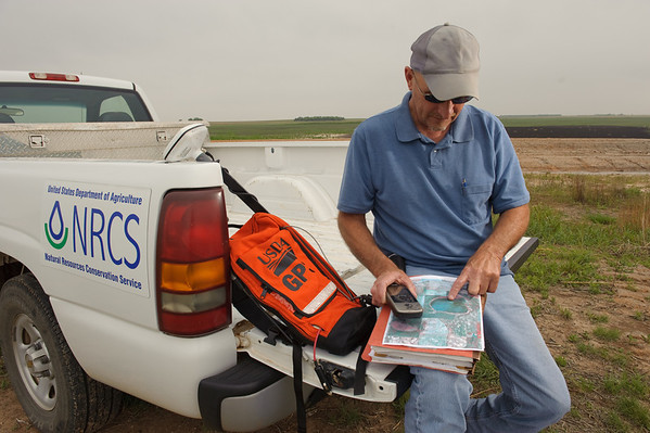 Danny Lamberth, DC in Anson, Texas, use GPS equipment in the field.