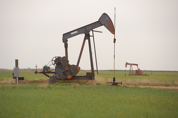 Seeing an oil well or natural gas well in a pasture is common in Anson, Texas.