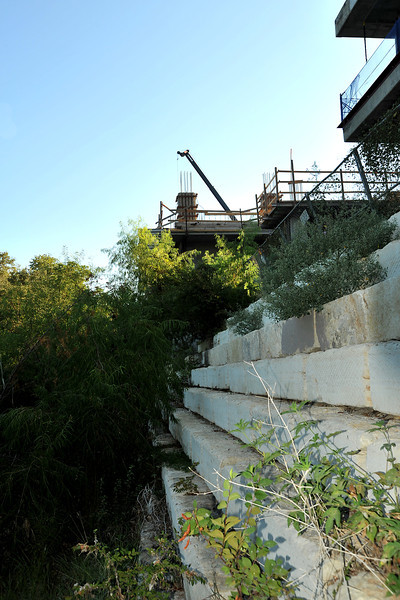Construction along Shoal Creek at W 6th Cirrus Logic building, encroaching on Shoal Creek