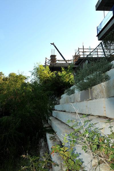 Construction along Shoal Creek at W 6th Cirrus Logic building, encroaching on Shoal Creek