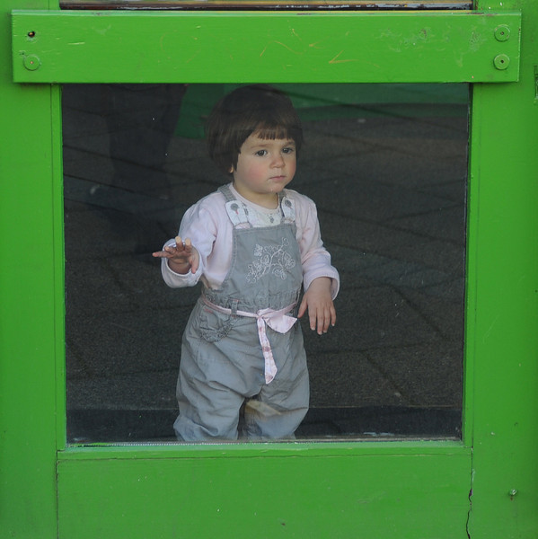 Young girl in restaurant window, Reykjavik, Iceland, Sep 2010
