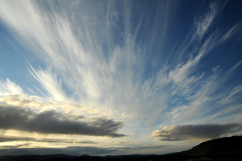 Cirrus clouds over Kerid volcanic crater lake, Iceland, Sep 2010