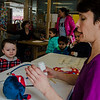 Declan Richardson, 3, gets a check-up for his bear by librarian Nicole  during a teddy bear adoption for children at the Fitchburg Public Library on Saturday, February 18, 2017. SENTINEL & ENTERPRISE / Ashley Green