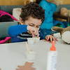 Ashraf Soliman works on some arts and crafts during a teddy bear adoption for children at the Fitchburg Public Library on Saturday, February 18, 2017. SENTINEL & ENTERPRISE / Ashley Green