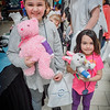 From left, Alivea Peladeau, 7, and her sister Alexia, 4, from Tyngsboro both get casts for their Teddy Bears. SUN/Caley McGuane