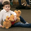 Song Time Fun and Stuffed Animal Parade was held at the Leominster Public Library Jodie Rachman who is known as Ukulele J. Having fun at the show with his Pooh Bear is Emmett Burbank, 4. SENTINEL & ENTERPRISE/JOHN LOVE