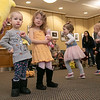 Song Time Fun and Stuffed Animal Parade was held at the Leominster Public Library Jodie Rachman who is known as Ukulele J. Leon Zapka, 2, and  Lily Zapka, 4, listen to the music during the program as kids run around the room around them. SENTINEL & ENTERPRISE/JOHN LOVE