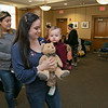 Song Time Fun and Stuffed Animal Parade was held at the Leominster Public Library Jodie Rachman who is known as Ukulele J. Participating in a teddy bear parade at the event is Lauren Diverdi and her son Luciano Diverdi, 1. SENTINEL & ENTERPRISE/JOHN LOVE