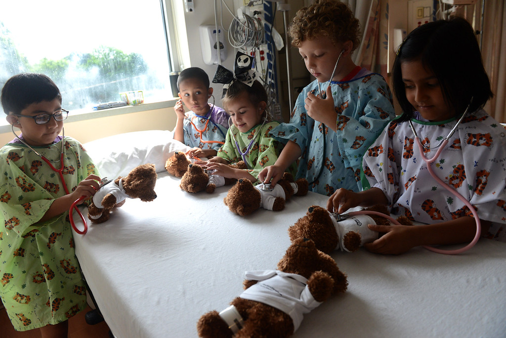 . Tania Barricklo-Daily Freeman    Kindergartners from Edson School in Kingston, N.Y.participate in the Teddy Bear Clinic Thursday morning at the Ambulatory Surgery Center at HealthAlliance Broadway Campus in Kingston, N.Y.Above, students give their bears a physical exam at one of the stations. From left are: Daniel Santos-Agustin,6, Alejandro Vidal-Garcia,6, Lilian Wolfeil,5, Eric Moon, 6, and Eshal Imtiaz,6.Children were given a teddy bear upon arrival and are told they have a broken arm or congestion. The children,often playing the role of a parent to comfort the bear, take them through different stations including a hand-washing station to prevent the spreadng of germs, a mock X-ray, a nebulizer to relieve congestion and a physical exam station.These activities , which include meeting the staff working at each station, help children become familiar and hopefully less fearful if they have the occasion to go to the emergency room.