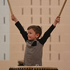 HOLLY PELCZYNSKI - BENNINGTON BANNER Student, Emerson Cummings raises his hands while druming during a visit from  Taiko drumming  sensai Stewart Peyton on Friday afternoon during a showcase of their skills after a week long residency at Fisher Elementary School in Arlington.