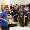 HOLLY PELCZYNSKI - BENNINGTON BANNER Kindergartner Joel Marko drums the tieko drum on Friday during a recital at Fisher Elementary School in Arlington.