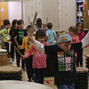 HOLLY PELCZYNSKI - BENNINGTON BANNER Kindergartners parade around drums on Friday afternoon during a Taiko drumming  recital where students of Fisher Elementary School showcased their skills after a week long residency.