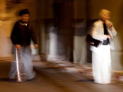 Elderly couple walking at night