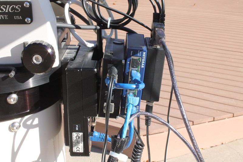 CP4 velcroed to Focus Boss II hub velcroed to Ethernet switch velcroed to Pegasus USB hub. Blue cables are Ethernet cables for CP4 and Focus Boss II. This Netgear Ethernet switch accepts 12VDC so no 12VDC to 5VDC converter necessary.