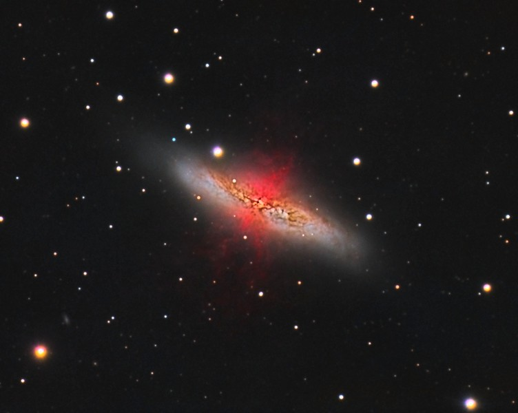 "M82: Cigar Galaxy in Ursa Major. LHaRGB. 0.46""/pixel image scale. Reprocessed using calibration with PixInsight.  Astrodon Luminance filter, 87 x 5 minutes, Unbinned 1x1. F/10, 2/15/2013. Astrodon 5nm Ha filter, 13 x 30 minutes, Unbinned 1x1. F/10, 2/17/2013.  Astrodon Red filter, 24 x 5 minutes, Unbinned 1x1. F/10, 3/9/2013.  Astrodon Green filter, 24 x 5 minutes, Unbinned 1x1. F/10, 3/9/2013.  Astrodon Blue filter, 27 x 5 minutes, Unbinned 1x1. F/10, 3/9/2013.   Celestron 8"" EdgeHD with Astro-Physics Mach1GTO GEM. Atik 460EX mono. Hutech OAG. Lodestar.   Captured with Nebulosity. Processed with PixInsight. PHD settings: RA Aggressiveness: 60, RA Hysteresis: 10, Max Dec Duration: 75, Min Motion: 0.70, Calibration Steps: 125msec, Auto/Resist Switching, Extreme dithering and Settled at < 0.5, 3 sec guiding exposure."