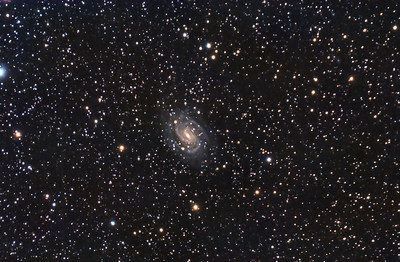 "NGC6384, Spiral Galaxy in Ophiuchus. 24 x 10 minutes, F/10, 6/10/2012. Seeing was not good.Celestron 8"" EdgeHD with Astro-Physics Mach1GTO GEM. SXVR-M25C. Hutech OAG. Lodestar. Capture and pre-processed (BPM, Bias, Flats Calibration) with Nebulosity. DeBayered, stacked and post-processed with PixInsight. PHD settings: RA Aggressiveness: 60, RA Hysteresis: 10, Max Dec Duration: 75, Min Motion: 0.50, Calibration Steps: 100msec, Auto/Resist Switching, Extreme dithering and Settled at < 0.5, 3 sec guiding exposure."