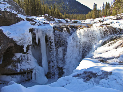 The Elbow River was still open but the falls were choked with ice. Despite the roar of the falls, it was a quiet, pristine, almost sacred moment.