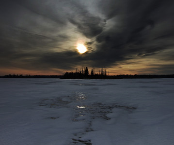 But when the action slows down and I can pause and breathe out, maybe that's the time for a long slow look across the winter ice of Astotin Lake in Elk Island National Park, to watch the sun rise. Maybe that's the time to revel in the beauty and mood of the moment.