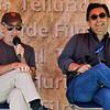 Director Jon Stewart and journalist Maziar Bahari speak at a seminar at Elks Park