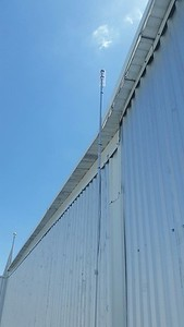 Use of telescoping pole to raise Access Point link above the roof line.