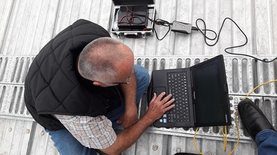 Balding man at work. Final frequency hunt and bandwidth.