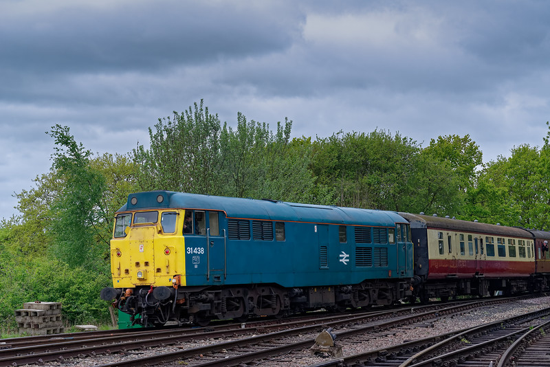 31438 departs from North Weald on the rear of the 12:15 Ongar - Epping Forest, <br /> on 27th April 2019.