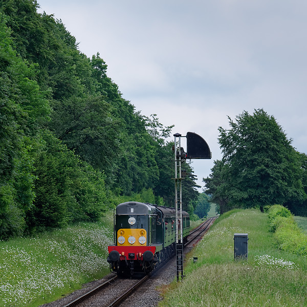 20059 passes Ropley Down Outer Home signal, with the 14:40 Alton - Alresford, <br /> on 1st June 2018.