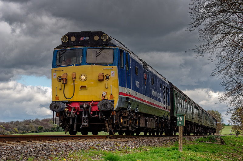 50027 approaches Stable Lane Bridge, with the 12:20 Alton - Alresford, on 23rd April 2016.