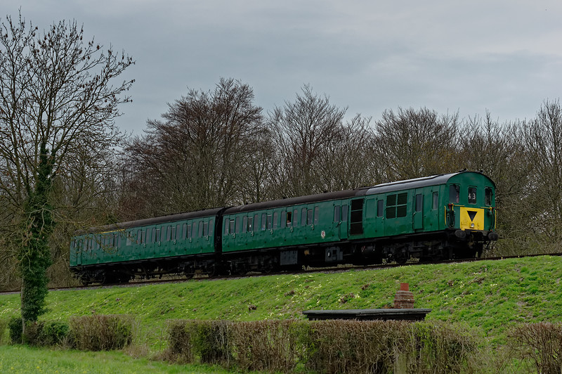 205025 passes the permanent way hut at Stable Lane, with the 09:15 Alresford - Alton, <br /> on 22nd April 2016.