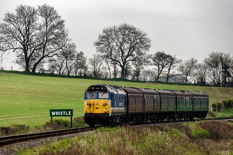 50027 passes the whistle board for Wanders Crossing, with the 15:00 Alton - Alresford, <br /> on 22nd April 2016.