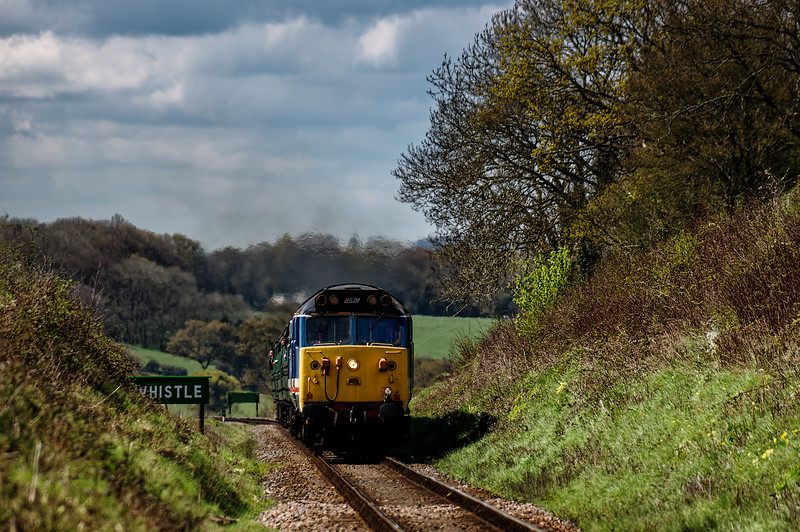50027 passes the Wanders Crossing whistle board, with the 11:15 Alresford - Alton, <br /> on 23rd April 2016.