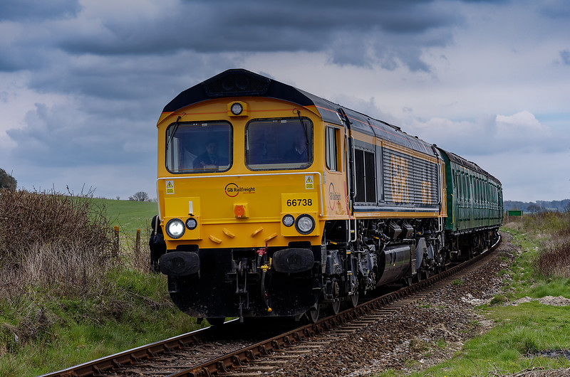 66738 and 205025 at Northside Crossing, with the 13:32 Ropley - Alresford, <br /> on 28th April 2013.