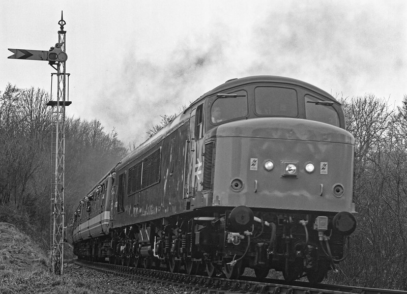 45132 passes the Alresford Distant signal with the 10:16 Alresford - Alton, on 5th March 1994. The 45 arrived at the Mid-Hants on 5th March 1992, it had travelled by rail from March. Exactly two years later it entered revenue earning service, with the above working. Scanned Negative.