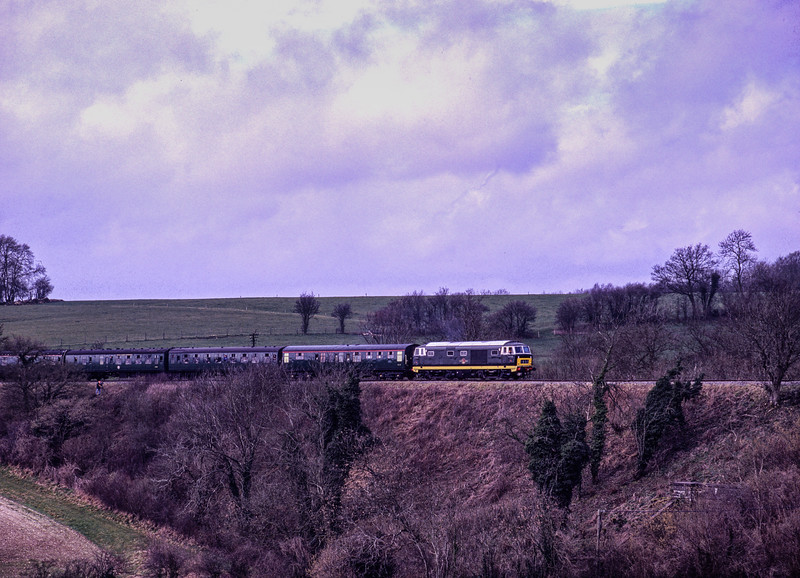 Hymek D7018 at the Grosvenor Road Bridge, with the 11:36 Alresford - Alton, <br /> on 5th March 1994. Scanned Transparency.