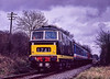 D7018 approaching Wanders Crossing with the 13:25 Alton - Alresford, on 5th March 1994. Scanned Transparency.