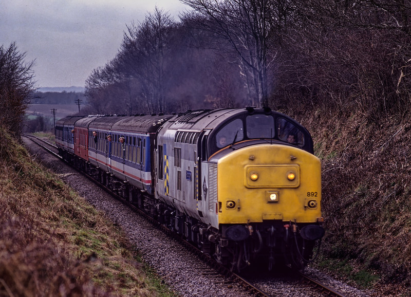 37892 approaches Bluebell Crossing with the 14:16 Alresford - Alton, on 6th March 1994. Scanned Transparency.