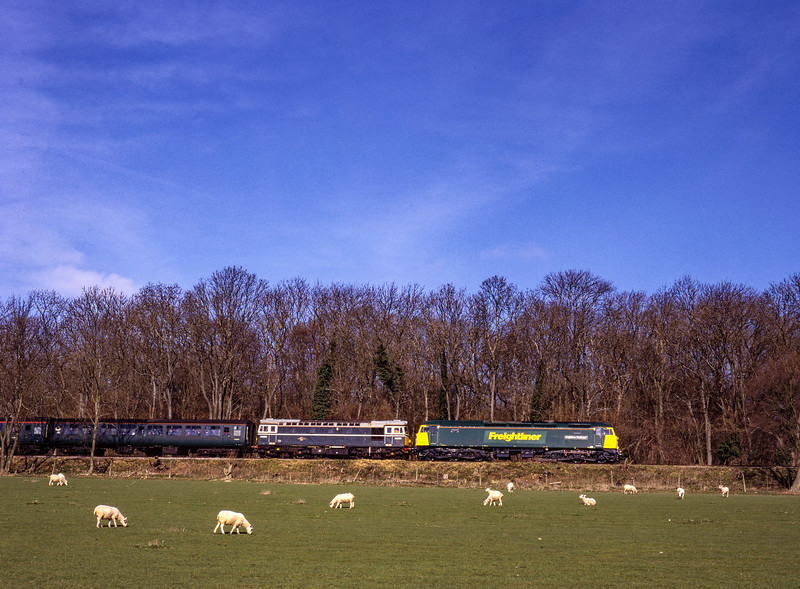 57011 and 33208 passing Baigents Copse with the 09:30 Alresford - Alton, <br /> on 5th March 2000. Scanned Transparency.