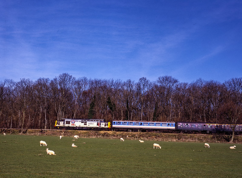 37906 passing Baigents Copse with the 09:40 Alton - Alresford, on 5th March 2000. <br /> Scanned Transparency.